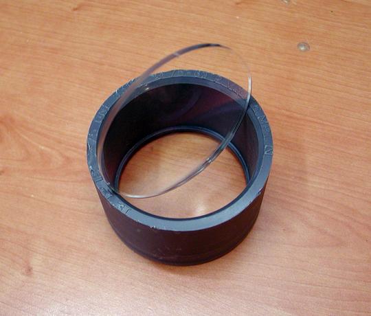 Lente y casquillo PVC